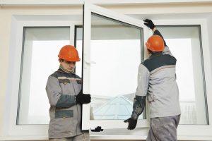 Cold Weather Window Installation, men installing window