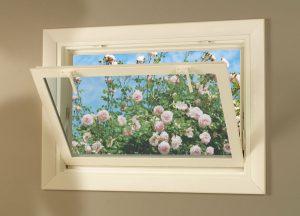 open hopper window with flowers outside