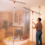 window installation in cold weather, man hangs plastic wall